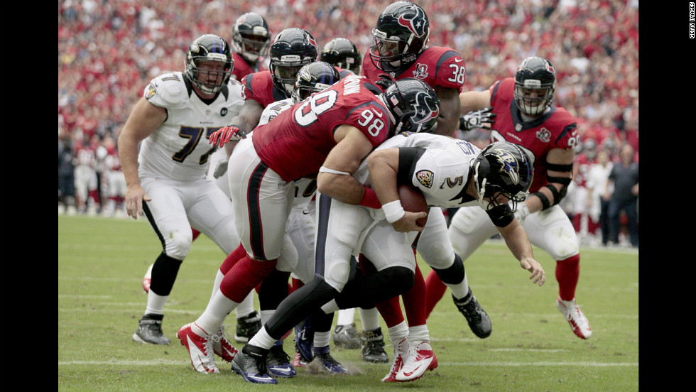 Connor Barwin of the Houston Texans sacks quarterback Joe Flacco of the Baltimore Ravens for a safety.