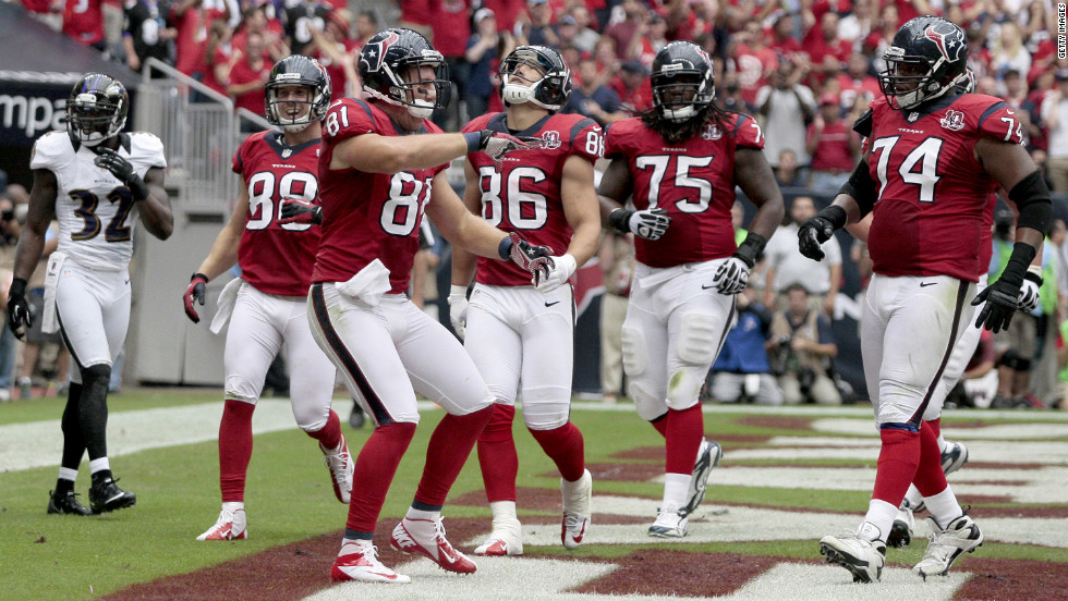 No. 81 Owen Daniels of the Houston Texans celebrates with teammates after catching a touchdown reception Sunday.