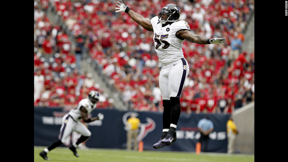 Terrell Suggs of the Ravens tries to knock down a pass by Texans quarterback Matt Schaub.