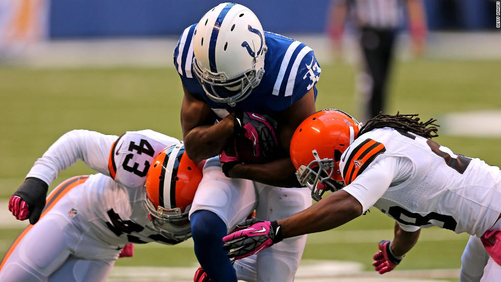 Vick Ballard of the Indianapolis Colts is hit by T.J. Ward, left, and Usama Young of the Cleveland Browns at Lucas Oil Stadium in Indianapolis on Sunday.
