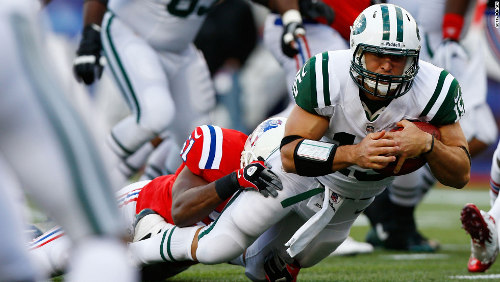 Quarterback Tim Tebow of the New York Jets runs the ball against the New England Patriots on Sunday at Gillette Stadium in Foxboro, Massachusetts.