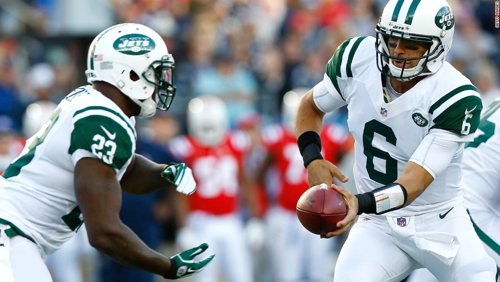 Jets quarterback Mark Sanchez hands the ball off to Shonn Greene.