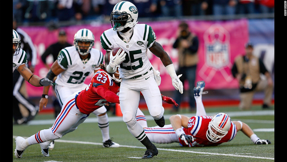 Joe McKnight of the New York Jets gains yardage in the first half against the Patriots.