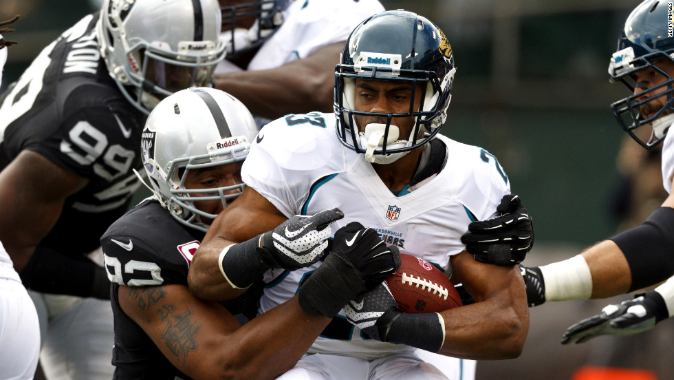 Rashad Jennings of the Jacksonville Jaguars is tackled by Richard Seymour of the Oakland Raiders in the backfield on Sunday at O.co Coliseum in Oakland, California.