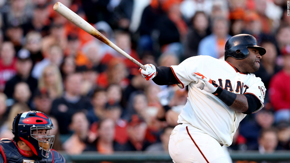 Pablo Sandoval of the Giants hits a double against the Cardinals.