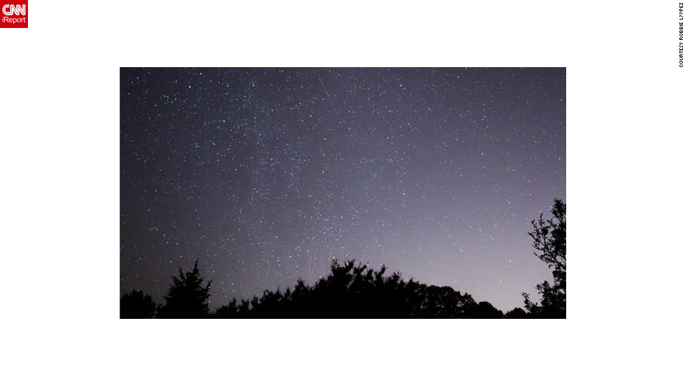 "<a href=""http://ireport.cnn.com/docs/DOC-861816"">Robbie López </a>stood out in a remote field in Chester, Virginia, to photograph the Orionid meteor shower."