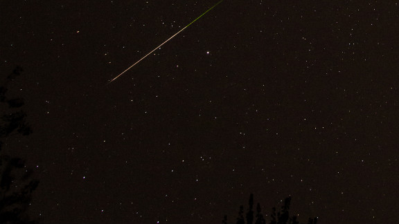 "Using a Canon 5D Mark II camera, Mike Black photographed the Orionid meteor shower early Sunday morning. ""When one of those bits of rock enters our atmosphere, it burns up and we get to enjoy a meteor shower. It"