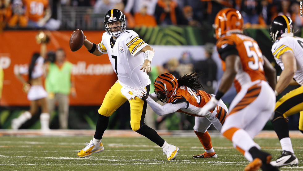 Quarterback Ben Roethlisberger of the Pittsburgh Steelers looks to pass under pressure from Reggie Nelson of the Cincinnati Bengals.