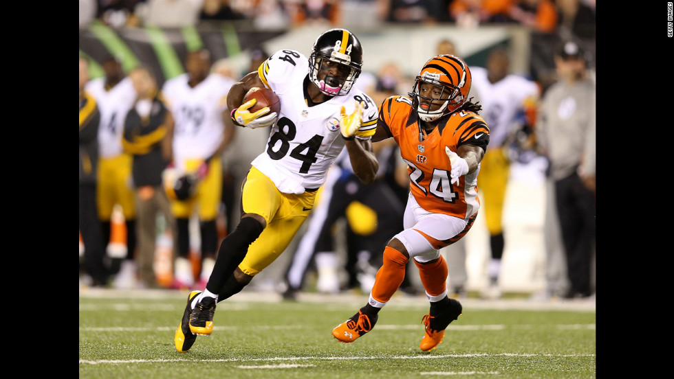 Antonio Brown of the Steelers runs with the ball past Bengals defender Adam Jones.