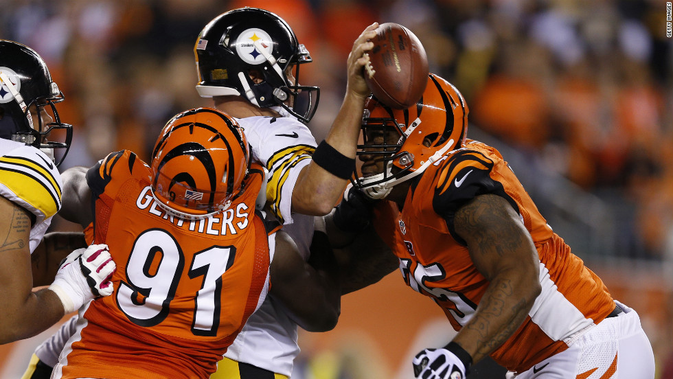 Robert Geathers, left, and Devon Still of the Bengals combine to sack and force a fumble by Steelers quarterback Ben Roethlisberger.