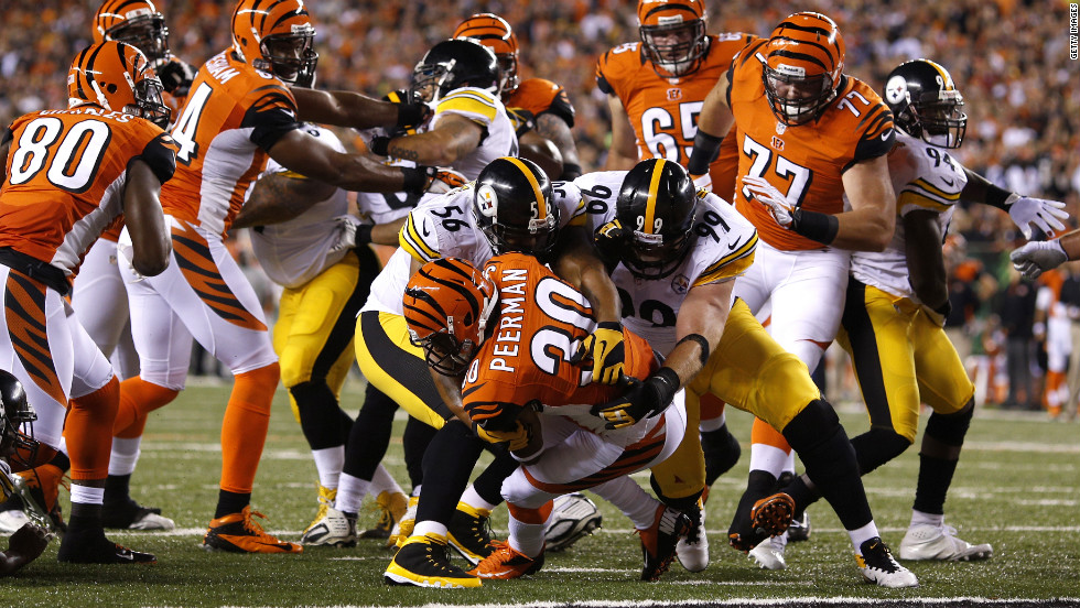 No. 30 Cedric Peerman of the Bengals rushes for a five-yard touchdown against the Steelers.
