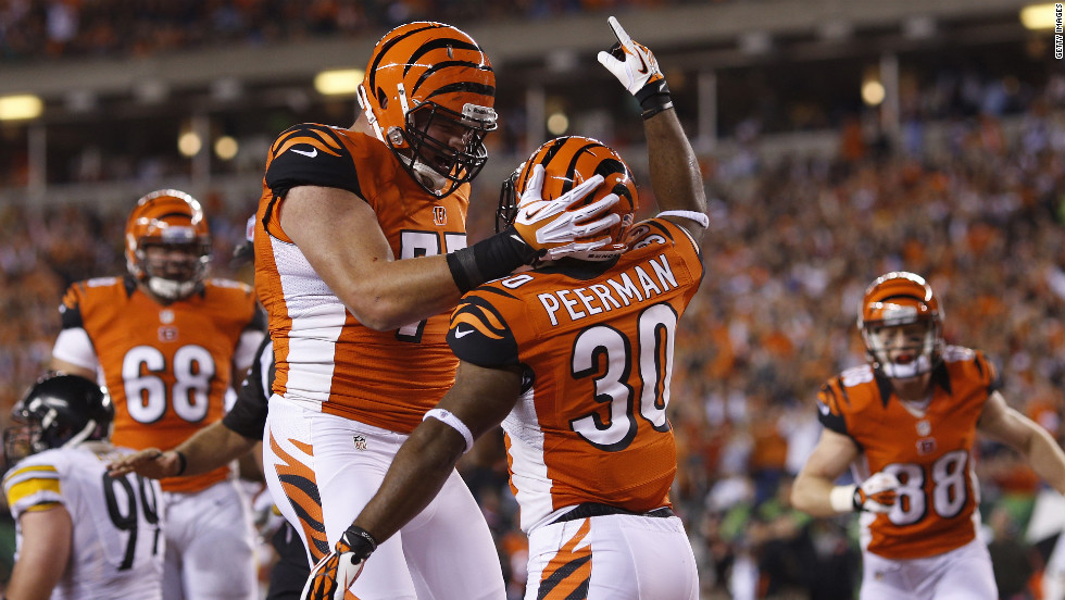Cedric Peerman of the Bengals celebrates with his teammates after rushing for a touchdown.