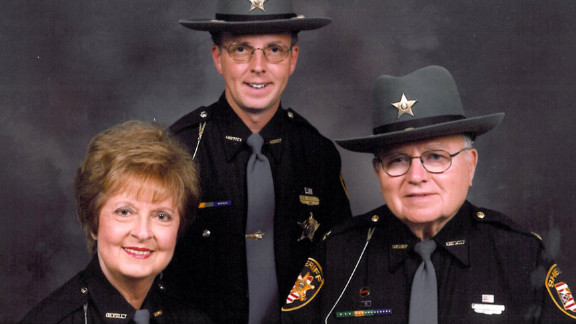 Sheriff Dwight E. Radcliff, shown with son Robert and wife Betty, hopes Robert will be elected to take his place.