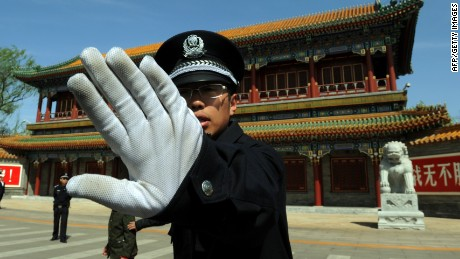 Chinese police block photos being taken outside Zhongnanhai, the Communist Party of China's central headquarters.
