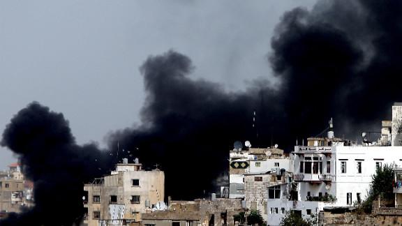 Smoke billows in Tripoli