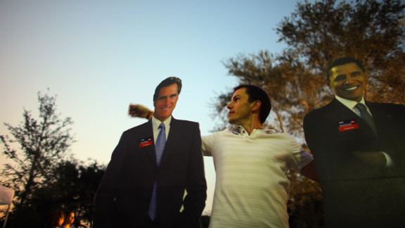 Bartek Wawruch stands between cardboard cutouts of Obama and Romney at Lynn University in Boca Raton, Florida, on Saturday, October 20, as the campus prepares for Monday