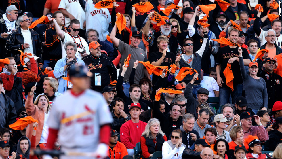 Giants fans cheer as Allen Craig of the St. Louis Cardinals bats in the first inning.