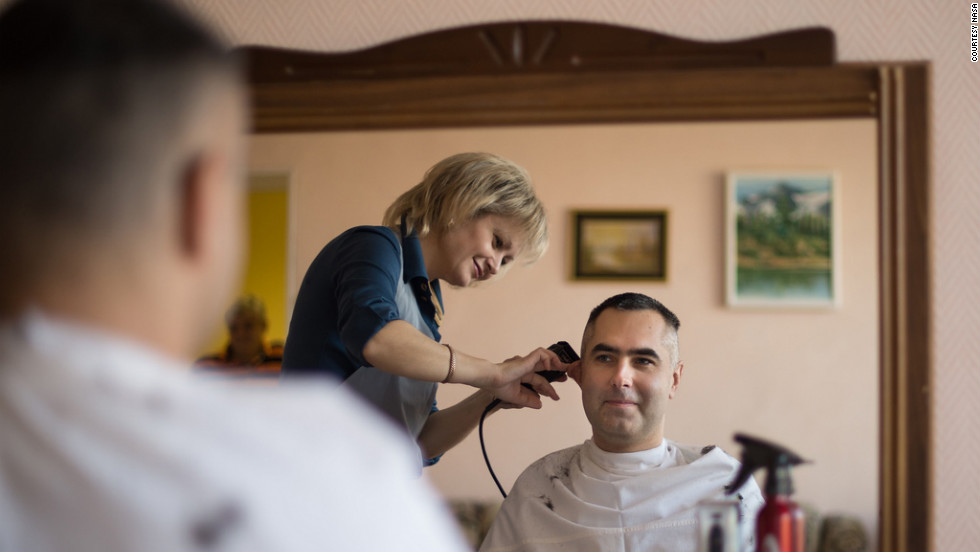 Tarelkin gets his hair cut at the Cosmonaut Hotel on Sunday, October 21, at the Baikonur Cosmodrome in Kazakhstan.