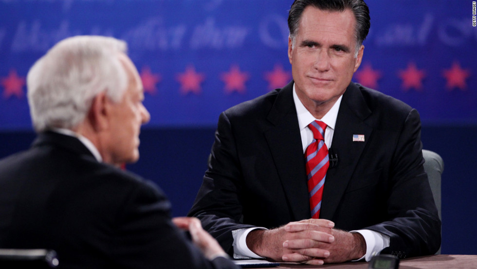Romney listens as Schieffer speaks during Monday night's debate.