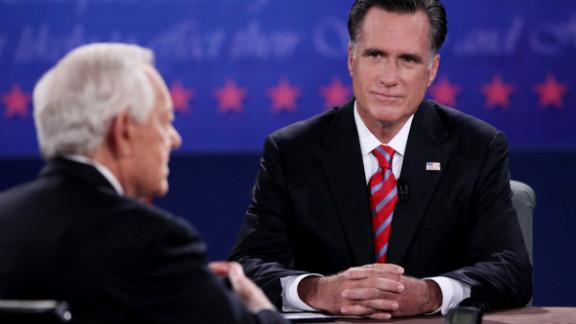 Romney listens as Schieffer speaks during Monday night