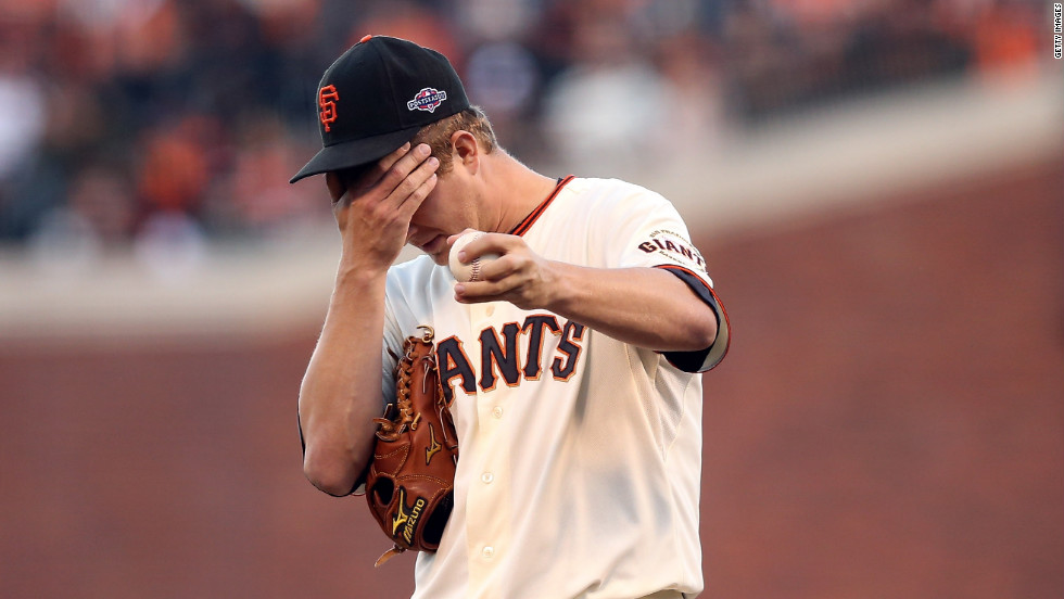 No. 18 Pitcher Matt Cain of the Giants reacts in the second inning.