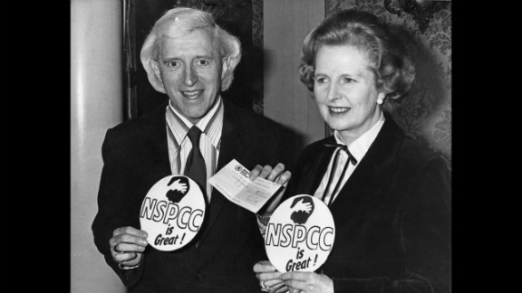 Savile poses with British Prime Minister Margaret Thatcher at a National Society for the Prevention of Cruelty to Children fund-raising presentation in 1980.