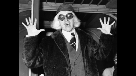 Savile arrives in London in 1972 on his way to Buckingham Palace, where he is to be awarded the Order of the British Empire.
