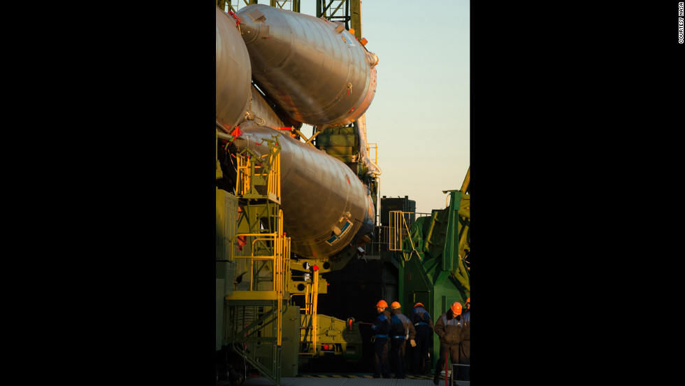 Technicians prepare the Soyuz rocket to be erected at the launch pad on Sunday.
