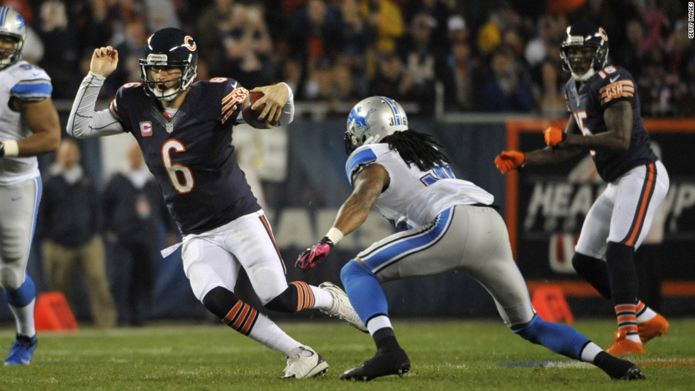 No. 6 Jay Cutler of the Bears runs against the No. 36 Jonte Green of the Lions.