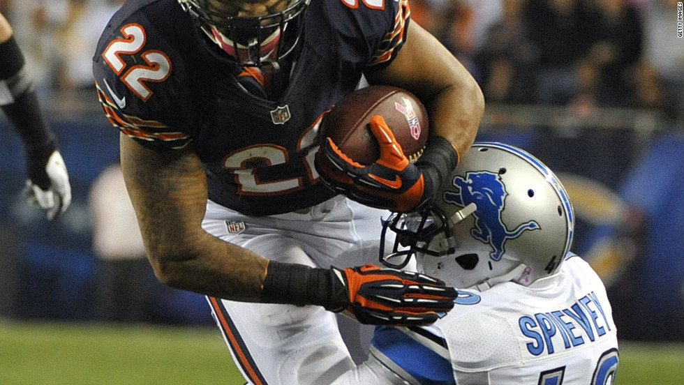 No. 22 Matt Forte of the Bears runs for 40 yards and is tackled by No. 42 Amari Spievey of the Lions.