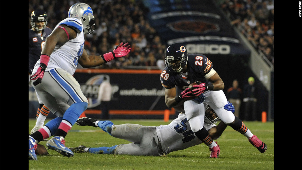 No. 29 Michael Bush of the Bears is tackled by No. 54 DeAndre Levy of the Lions.