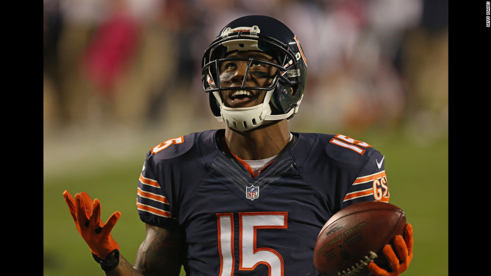 No. 15 Brandon Marshall of the Bears celebrates a first quarter touchdown catch against the Lions.