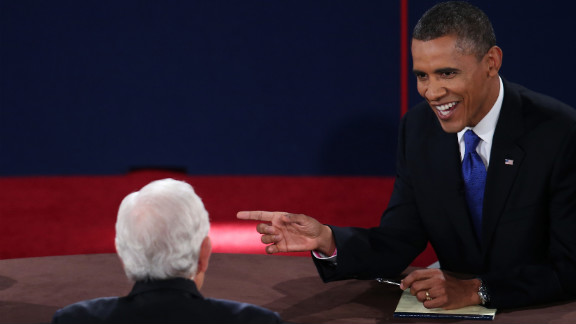 Obama looks to Schieffer while debating Romney.