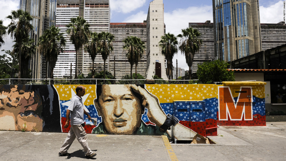 Journalist Girish Gupta says Venezuela is still recovering from the hangover of the brutal campaign between Hugo Chavez (pictured in a Caracas mural) and opposition challenger Henrique Capriles.