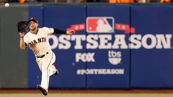 No. 7 Gregor Blanco of the Giants catches a fly ball in the fourth inning.