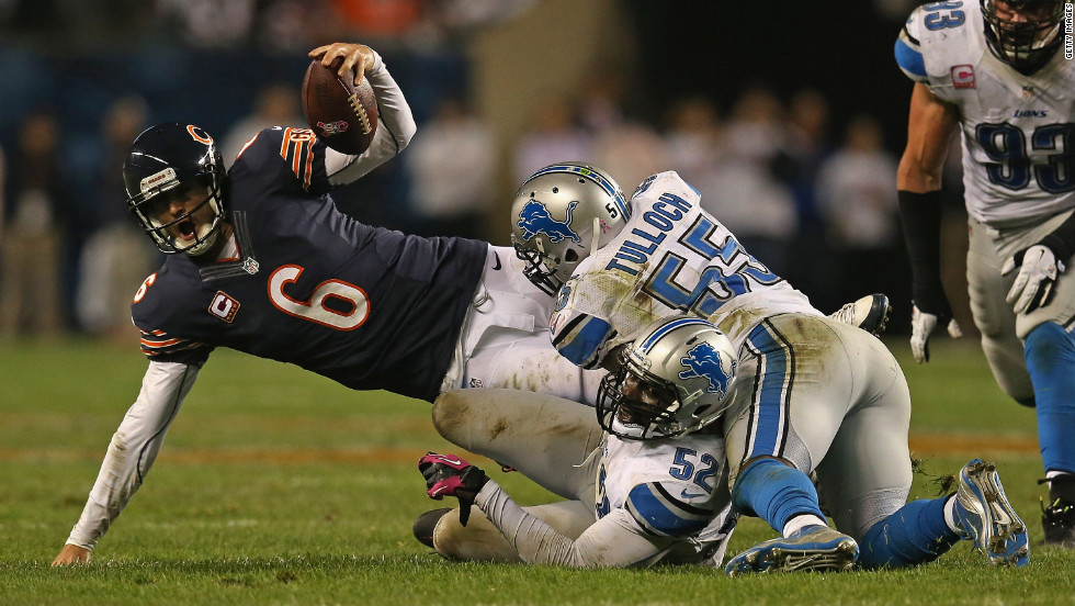 No. 6 Jay Cutler of the Bears is sacked by No. 52 Justin Durant and No. 55 Stephen Tulloch of the Lions.