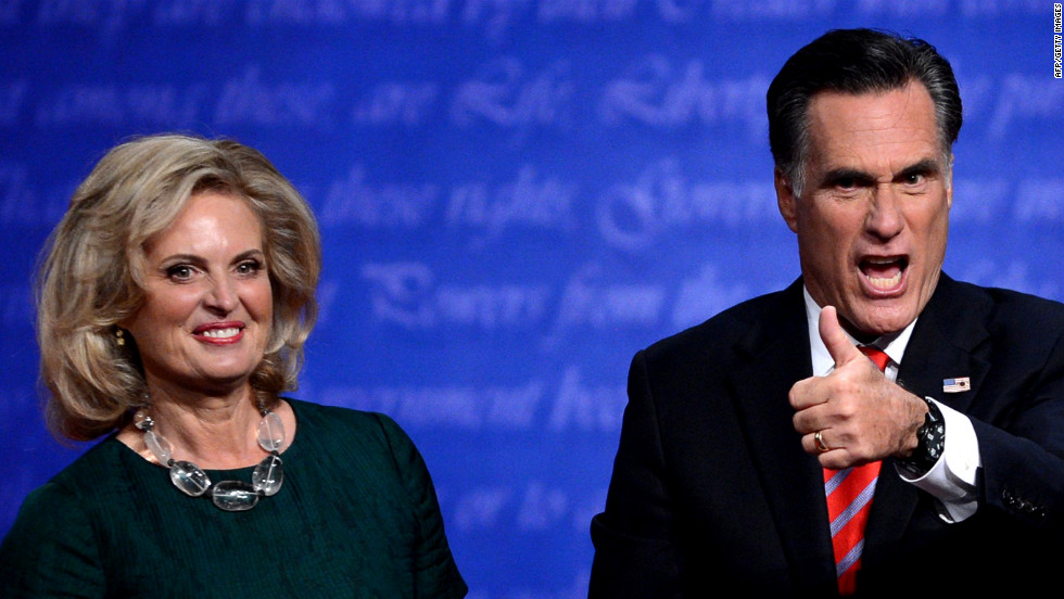 Romney gestures beside his wife, Ann, on Monday.