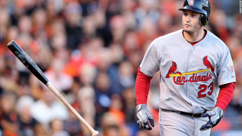 David Freese of the St. Louis Cardinals throws his bat after he walks in the second inning on Monday.