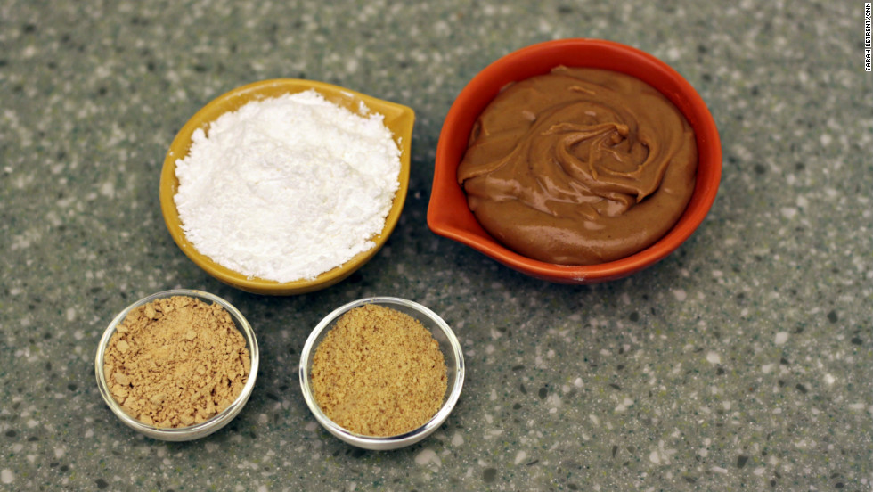 Here's a trade secret: Most of the big manufacturers of peanut butter cups add extra flavor and texture to their peanut butter filling by adding peanut meal to the peanut butter. This also creates a drier, crumblier texture that many people have come to expect in peanut butter cups. The best way to replicate this at home is by adding a combination of peanut flour and graham cracker crumbs to the peanut butter in the recipe. You can use one, both or neither. Peanut flour is available at many specialty food shops and online retailers.
