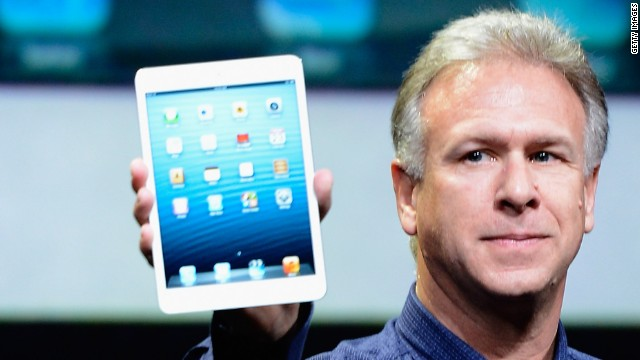 Apple marketing chief Phil Schiller holds up an iPad Mini, the company's newest gadget. Pre-orders start Friday.