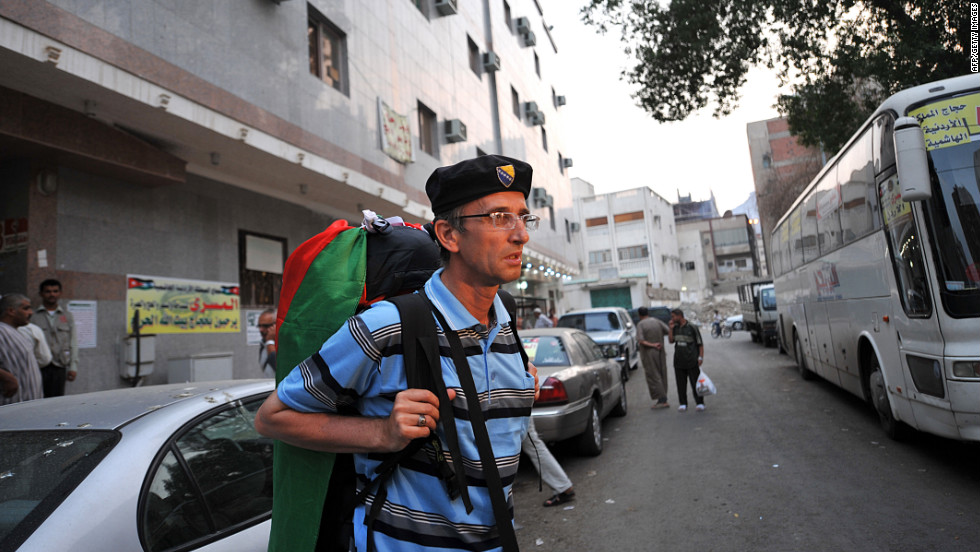 Bosnian Muslim pilgrim Senad Hadzic, 47, who left December on a pilgrimage to Mecca by foot, walks in the holy city on Tuesday. Hadzic said he had walked through Bosnia, Serbia, Bulgaria, Turkey, Syria and Jordan with a backpack weighing 20 kilograms, or 44 pounds.
