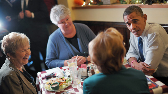 The president speaks with residents during a lunch with a group of Obama for America volunteers at an unanounced stop at Antonella