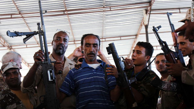 Libyans wait to hand over weapons to the military in Benghazi on September 29 in an effort to disarm militias.