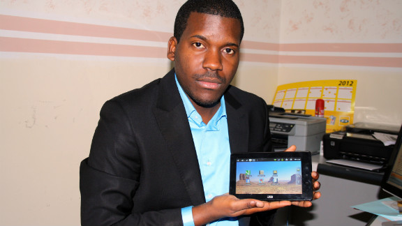 Verone Mankou, the inventor of Africa's first handheld tablet to rival the iPad, shows his invention, the Way-C.