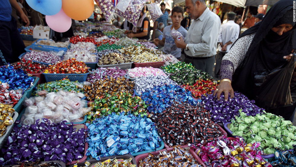 A Palestinian woman buys sweets in preparation for Eid al-Adha in Gaza City on Thursday.