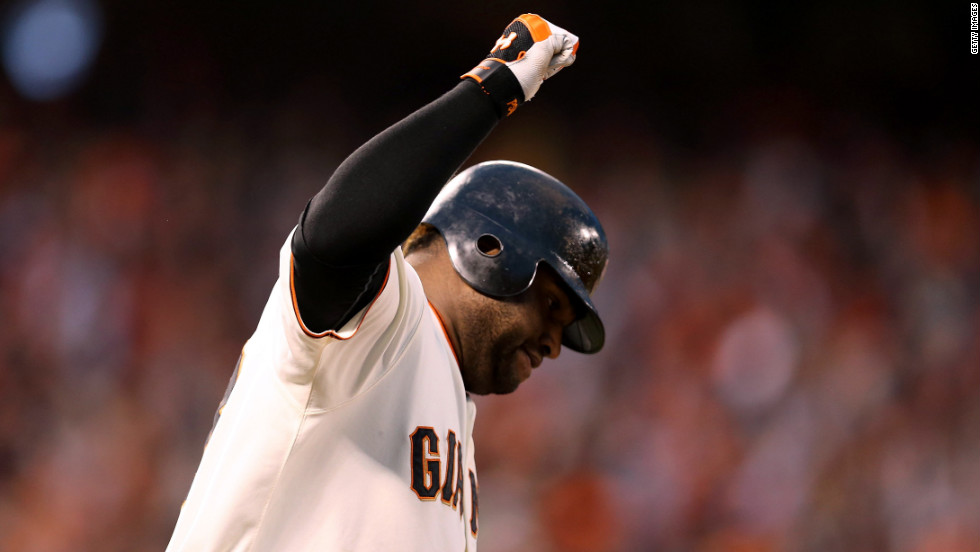 Pablo Sandoval of the San Francisco Giants rounds the bases after hitting a two-run home run to left field against Justin Verlander of the Detroit Tigers in the third inning.
