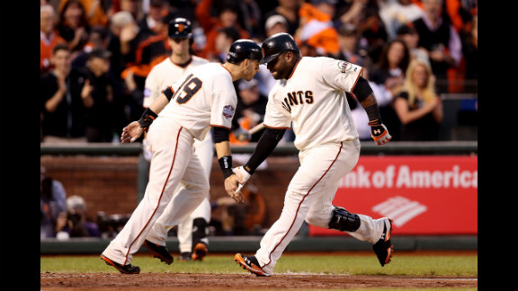 Sandoval, right, of the San Francisco Giants, celebrates with teammate Marco Scutaro, left, after crossing the plate from a two-run home run.