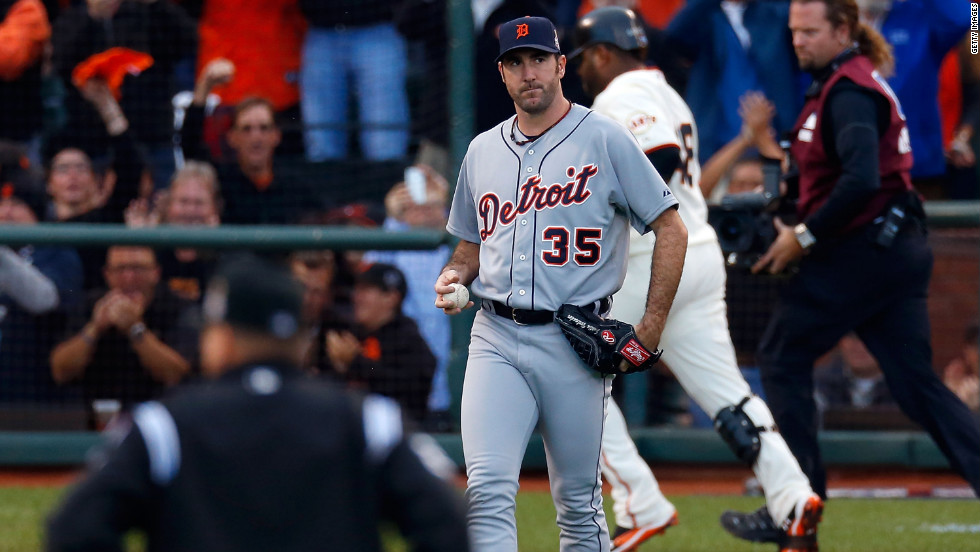 Justin Verlander of the Detroit Tigers grimaces as Pablo Sandoval of the San Francisco Giants rounds the bases after hitting a solo home run in the first inning.