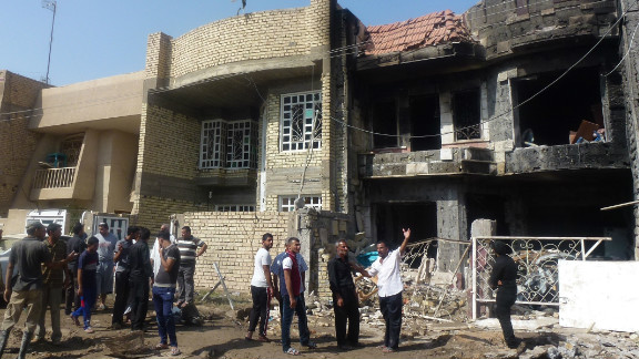 Iraqis inspect damage after multiple mortars struck the Chikuk neighbourhood in Baghdad on October 23, 2012.