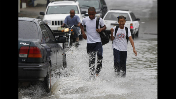 Students walk in floodwater from Hurricane Sandy